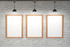 White board on brick wall with ceiling lamp Royalty Free Stock Image