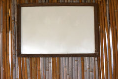White board hanging on bamboo wall Royalty Free Stock Photos