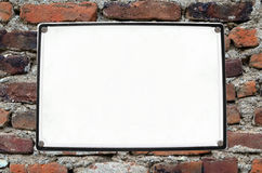 White Board On Old Brick Wall Royalty Free Stock Images