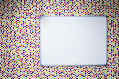 White board and optical illusion. Over multicolor dots wall pattern royalty free stock photography