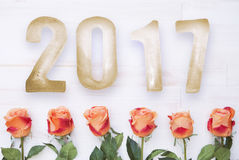 2017 on white board with orange roses Stock Photography