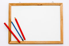 White board and pencil on the white background Stock Image