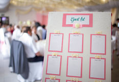 White board with pink decoration and ribbons and a guest list Royalty Free Stock Image
