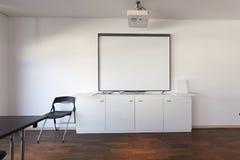 White board - projector screen in modern board room Stock Image