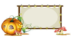 White board and pumpkin house Royalty Free Stock Photos