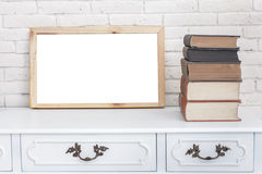 White board and stack of books on vintage desk table Stock Image