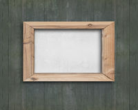 White board with wooden frame on old green wood wall Stock Image