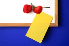 White-board with yellow note royalty free stock photography