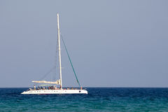White boat. In a calm water Stock Images