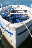 White boat. White wooden fishing boat in small croatian village Stock Images
