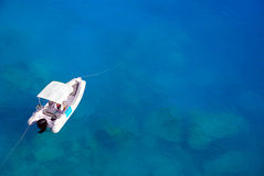 White boat. Image of a white boat floating on blue waters royalty free stock photos