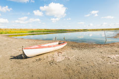White boat on the banks of a natural pond Royalty Free Stock Photography
