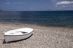 White boat at the beach Stock Photos