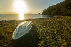 White boat on the beach with forest and sky Stock Photos