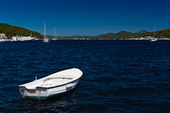 White boat at blue sea. Adriatic coast Royalty Free Stock Images