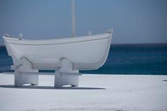 White boat, blue sea, lines Stock Image