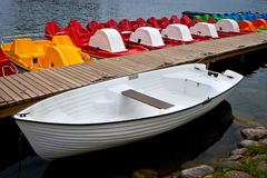 White boat and catamarans on moorage Royalty Free Stock Images