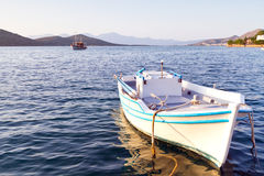White boat at the coast of Crete Stock Image