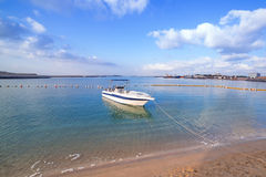 White boat on the coast of Persian Gulf Royalty Free Stock Images