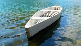 White boat on emerald green lake, Royalty Free Stock Photos