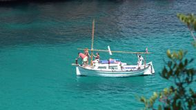 White boat floating on turquoise water sea. UHD 4K stock video