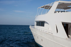 The white boat floats by sea. The white boat floats by the blue sea Royalty Free Stock Photos