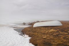 White boat in fog. Misty day by frozen lake in Norway with white boat upside down Royalty Free Stock Photography