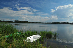 White boat on the lake shore. White wooden boat on the lake shore Royalty Free Stock Photos