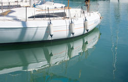 White boat moored in green water. PALMA DE MALLORCA, SPAIN - APRIL 19, 2015: White boat moored in green water with reflections on April 19, 2015 in Palma de Royalty Free Stock Photo