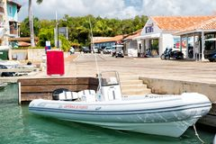 White boat moored in sea dock on tropical background Stock Photo