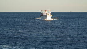 White boat moves towards the camera stock video footage