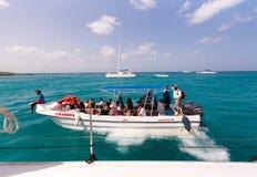 White boat near the rocky shore in Bayahibe, La Altagracia, Dominican Republic. Copy space for text. White boat near the rocky shore in Bayahibe, La Altagracia Stock Photo