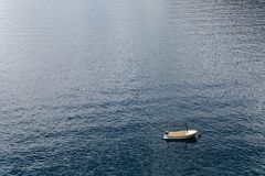 White boat with oars berth. At sea Royalty Free Stock Images