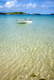 White Boat On Clear Sea. Stock Photos
