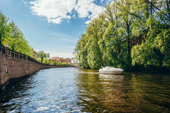 White boat on one of the canals and rivers of St. Petersburg. View from the water Royalty Free Stock Photo