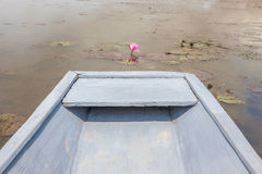 White boat in pink lotus water lily pond, tranquil rural scene.  Royalty Free Stock Images