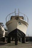 White boat on repairing dock Royalty Free Stock Photo