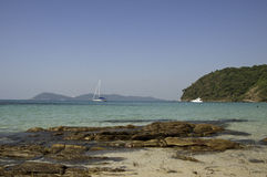 White boat with rocks on ocean in Thailand Royalty Free Stock Photo