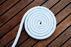 White boat rope coiled on the deck Stock Image
