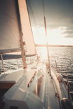 White boat with a sail on the water Royalty Free Stock Photography