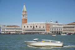 White boat sailing on the Grand Canal in Venice Royalty Free Stock Images