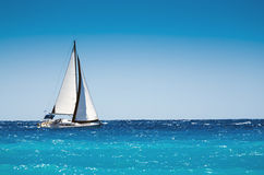 White boat sailing in the open blue sea. In Greece Stock Image