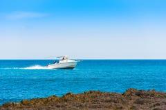 A white boat sails on the sea in Bayahibe, La Altagracia, Dominican Republic. Copy space for text. A white boat sails on the sea in Bayahibe, La Altagracia Stock Photo