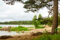 White boat on sandy shore. Hamina camping, Finland, Suomi Stock Photo