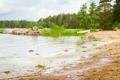 White boat on sandy shore. Hamina camping, Finland, Suomi Royalty Free Stock Photo