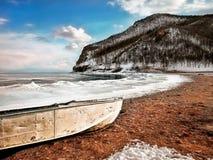 White Boat on Seashore Near Mountain Under White and Blue Sky Stock Photos