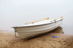 White boat on the shore misty morning Royalty Free Stock Images