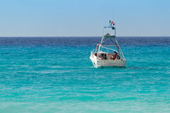 White boat on turquise Caribbean Sea. Of Mexico Royalty Free Stock Images