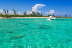 White boat on the turquise Caribbean Sea. Of Mexico Stock Image