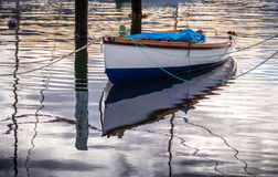 White boat with a water reflection Royalty Free Stock Photo